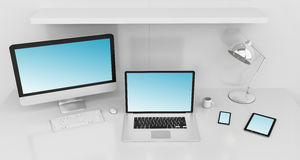 Modern white desk interior with computer and devices 3D renderin. Modern white desk office interior with computer and digital devices and blue screen 3D Royalty Free Stock Photography