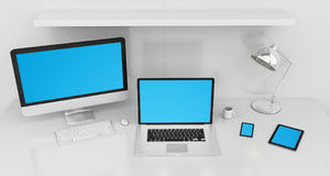 Modern white desk interior with computer and devices 3D renderin Royalty Free Stock Images