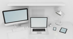 Modern white desk interior with computer and devices 3D renderin. Modern white desk office interior with computer and digital devices and blue screen 3D Royalty Free Stock Image