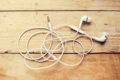 Modern white earphone, white in ear headphone. stock image