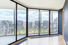 Modern white empty loft apartment interior with parquet floor and panoramic windows, Overlooking the metropolis city.  stock photo