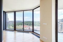 Modern white empty loft apartment interior with parquet floor and panoramic windows, Overlooking the metropolis city.  royalty free stock photos