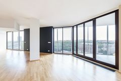 Modern white empty loft apartment interior with parquet floor and panoramic windows, Overlooking the metropolis city stock photos