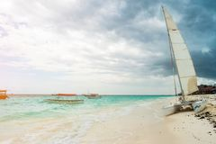 Modern white expensive catamaran vessel ashore Royalty Free Stock Images