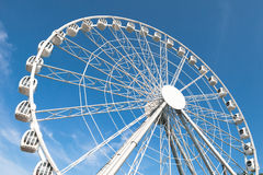 Modern white ferris wheel against blue background Royalty Free Stock Photography
