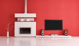 Modern white fireplace and home tv system. Contemporary fireplace with lcd tv and speaker in a red lounge Royalty Free Stock Photo