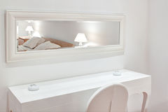 Modern white furniture the bedroom. Royalty Free Stock Images