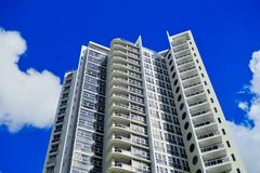 Modern Apartment Tower With Blue Sky and White Clouds, Sydney, Australia
