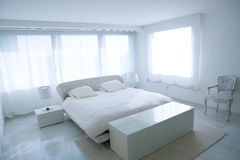 Modern white house bedroom with marble floor stock photos