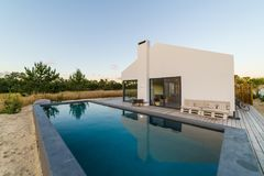 Modern house with garden swimming pool and wooden deck Stock Photography