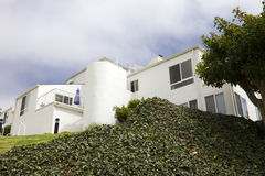 Modern White House On A Hill In California. Large modern newer white home on a steep hill in California Royalty Free Stock Photo