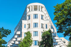 Modern white house seen in Berlin. Modern white multi-family house seen in Berlin, Germany Royalty Free Stock Images