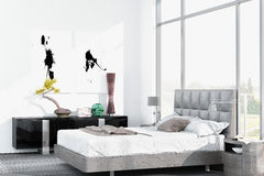 Modern white king-size bed against floor to ceiling window Stock Photography
