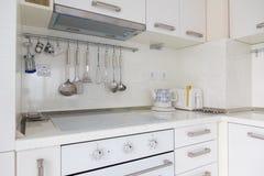 Modern white kitchen. With appliances and supplies Stock Photos