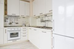 Modern white kitchen. With appliances and supplies Stock Photos