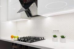 Modern white kitchen. Modern white and black kitchen, minimalistic clean design Royalty Free Stock Photo