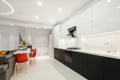 Modern white kitchen and dining room Royalty Free Stock Image