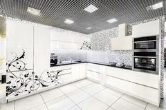Modern white kitchen furniture. Painted front surface. The material used in the manufacture - MDF stock photo
