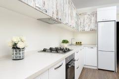 Modern white kitchen interior stock photography