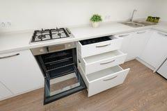 Modern white kitchen interior stock images