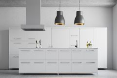 Modern white kitchen interior. With a concrete floor, white cupboards and countertops and original ceiling lamps. 3d rendering mock up Stock Photography