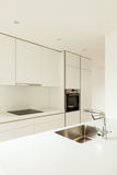 Modern white kitchen Stock Images