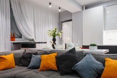 Modern white kitchen and living room Stock Images