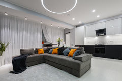 Modern white kitchen and living room Stock Image