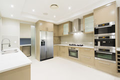 Modern white kitchen in new luxurious home Stock Photography