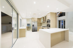 Modern white kitchen in new luxurious home. Modern kitchen with stainless steel appliances in Australian mansion Royalty Free Stock Image