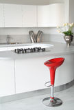 White kitchen and red stool Royalty Free Stock Photos