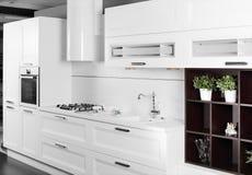 Modern white kitchen with stylish furniture. Luxury white kitchen interior with modern furniture Royalty Free Stock Photos