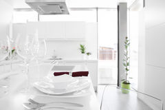 Modern white kitchen with stylish furniture Royalty Free Stock Photo