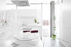Modern white kitchen with stylish furniture Royalty Free Stock Photo