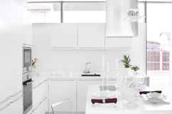 Modern white kitchen with stylish furniture Royalty Free Stock Photography