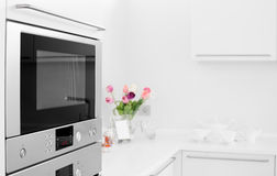 Modern white kitchen with stylish furniture Stock Image