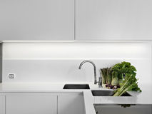 Modern white kitchen with vegetables Royalty Free Stock Image