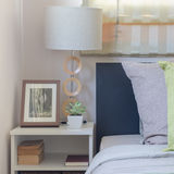 Modern white lamp on table with pillows on bed Royalty Free Stock Images