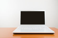 Modern white laptop Stock Photography