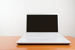 Modern white laptop Stock Photography