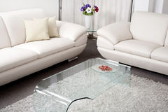 Modern white leather couch. In living room Royalty Free Stock Images