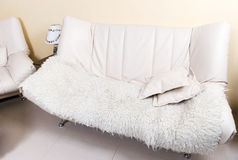 Modern white leather sofa with fell Royalty Free Stock Photography