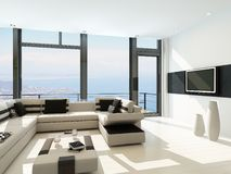 Modern white living room interior with splendid seascape view Royalty Free Stock Photography