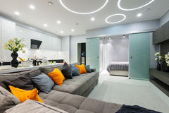 Modern white living studio with bedroom doors open Stock Photography