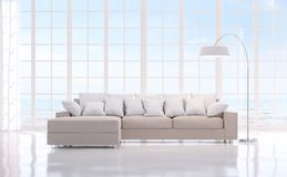 Modern white livng room with sea view 3d rendering image.There are large window overlooks to sea view. Modern white livng room with sea view 3d rendering image Royalty Free Stock Photos