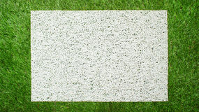 Modern white mat on green grass background. Top view Stock Images