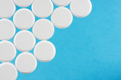 Modern white medical pills on a medical background Royalty Free Stock Photos