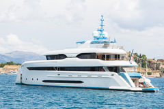 Modern white mega yacht in the blue sea. Rich people on holidays. Stock Image