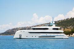 Modern white mega yacht in the blue sea. Rich people on holidays. Stock Photos