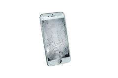 Modern white mobile phone with broken screen isolated on white background Stock Photography